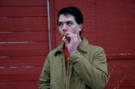 Zach Limbert smokes a cigarette