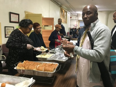 Antoine waits in line at a soup kitchen hosted by Tindley Temple Methodist Church