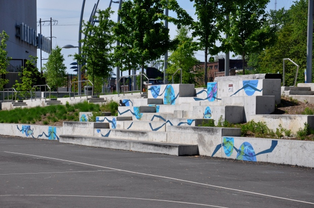 The mural ends at the pavement above the water basin. (Greta Iverson/for NewsWorks)